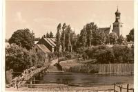 Widok na plebanię, kościół i Kozi Most
